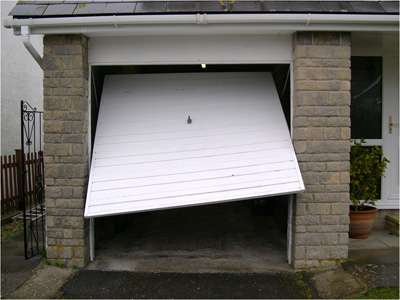 Signs your garage door needs repairs or replacement for Garage door installation jobs